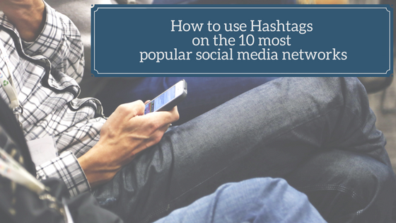 Man with phone, looking for insights and tips, how to use hashtags on the 10 most popular social media networks.
